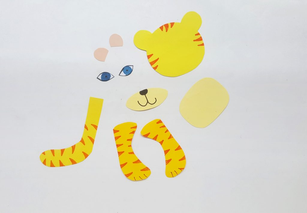 Colored pieces to assemble to make a Tiger out of a cardboard tube