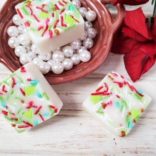 Sugar Cookie Sugar Scrub Bars on white beads in a brown bowl
