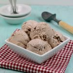 Homemade Weight Watchers Ice Cream in a white bowl on a red and white napkin