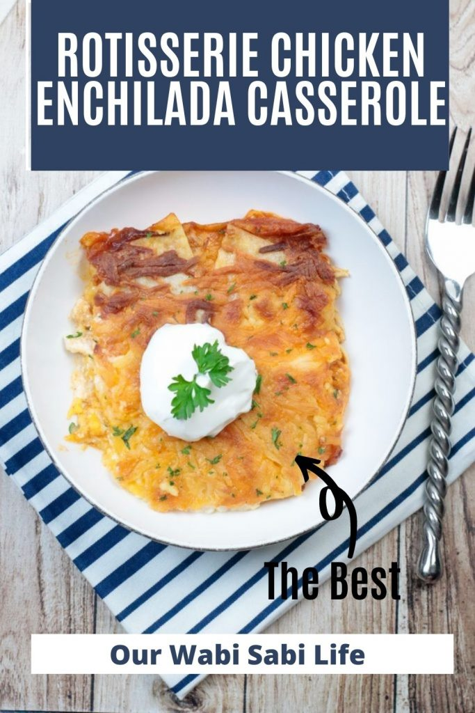 A white plate with a slice of chicken enchilada casserole made from rotisserie chicken
