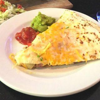A Cheesy Chicken Quesadilla on a white plate