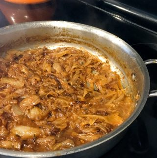 Savory Caramelized Onions in a skillet on the stove