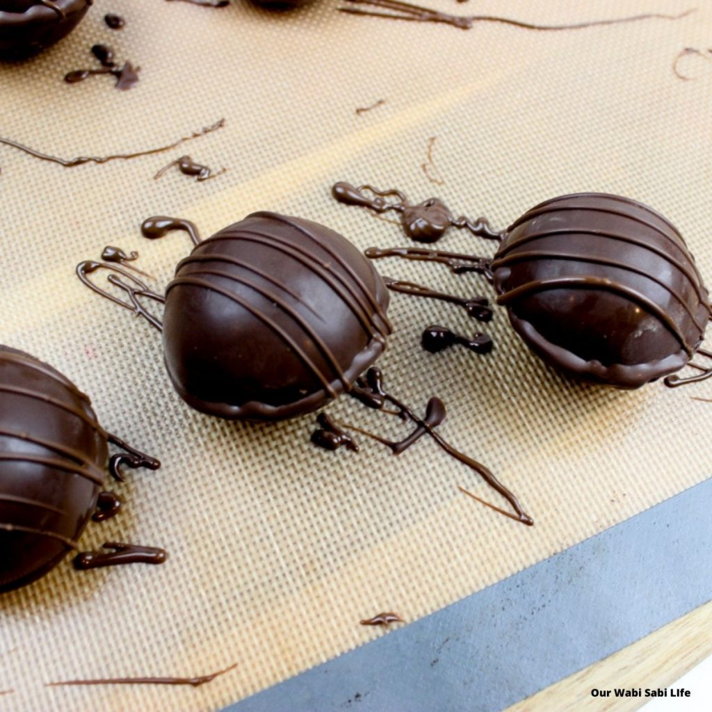 Drizzled chocolate over hot chocolate bombs