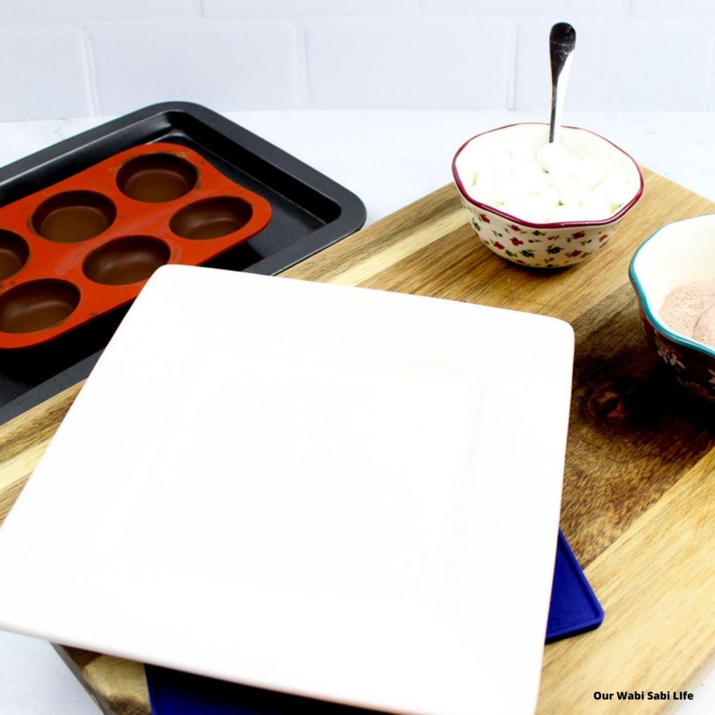 warm plate to melt edges of the hot chocolate bombs after they've set