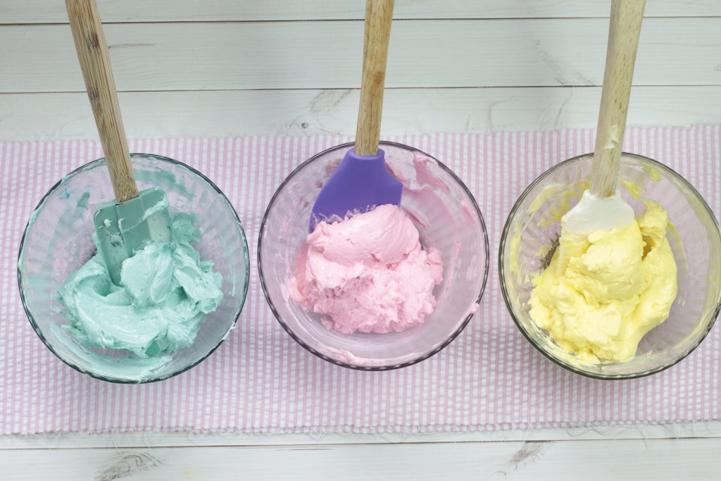 3 colors of frosting in a bowl