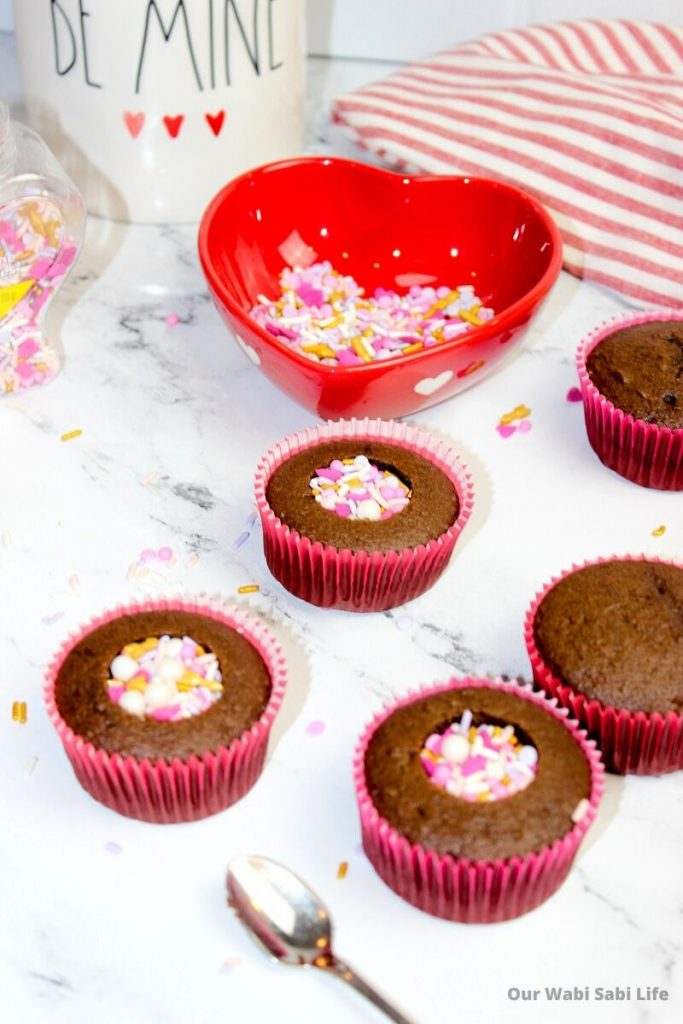 Chocolate cupcakes with sprinkles in the middle