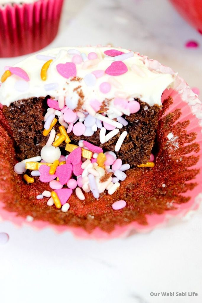 Chocolate Cupcakes with valentine sprinkles inside and topped with vanilla frosting and sprinkles