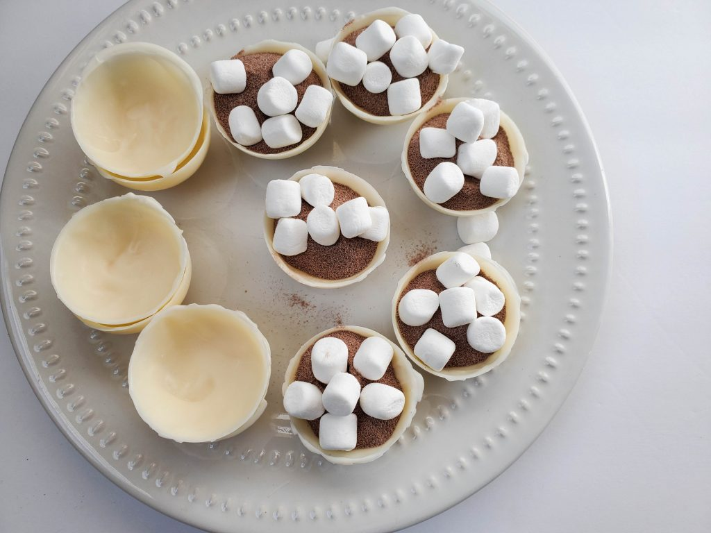 white chocolate hot chocolate bomb filled with cocoa and marshmallows