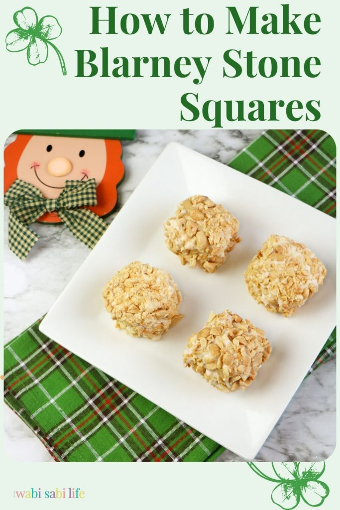 Four Blarney Stone Squares covered in peanuts and on a white plate