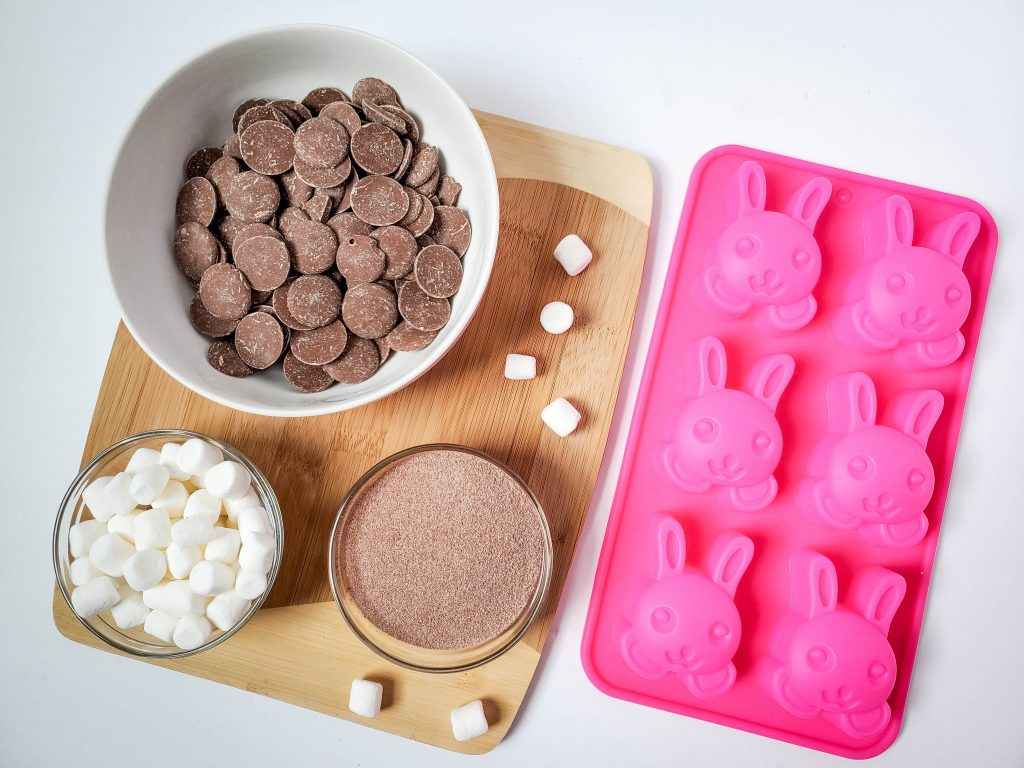 Ingredients and mold needed to make Bunny Face hot cocoa balls