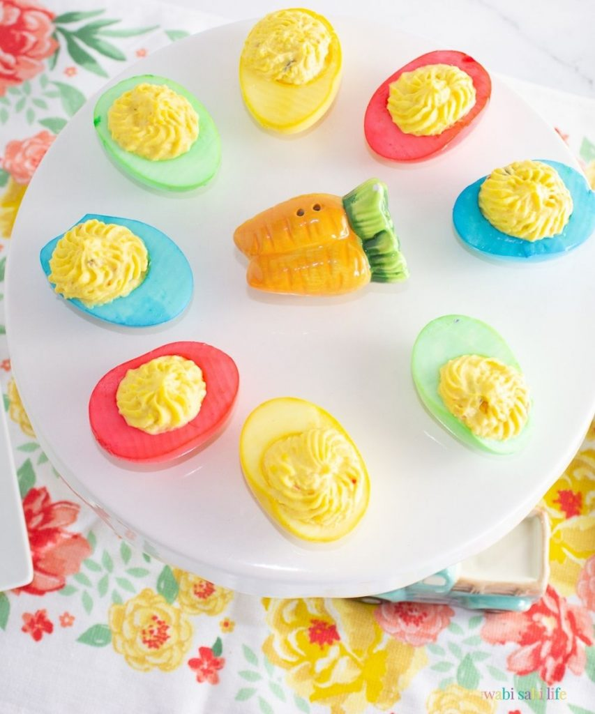 colored eggs on a white tray