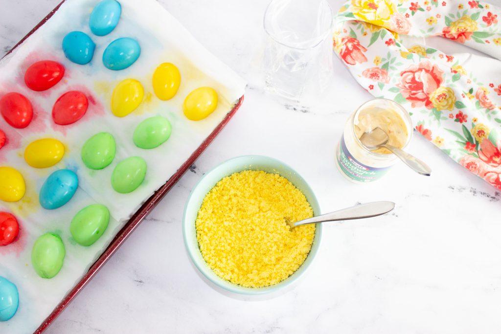 Mashing egg yolks in a blue bowl