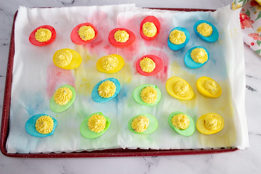 colored boiled eggs on a tray