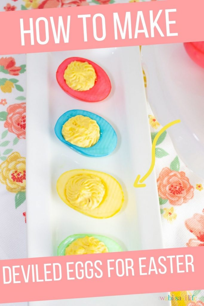 Brightly colored deviled eggs on a white tray for Easter on a flowered towel