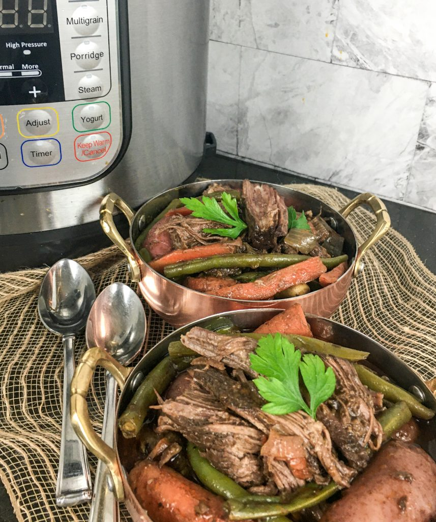 Pot Roast that has cooked in an Instant Pot with vegetables and topped with parsley