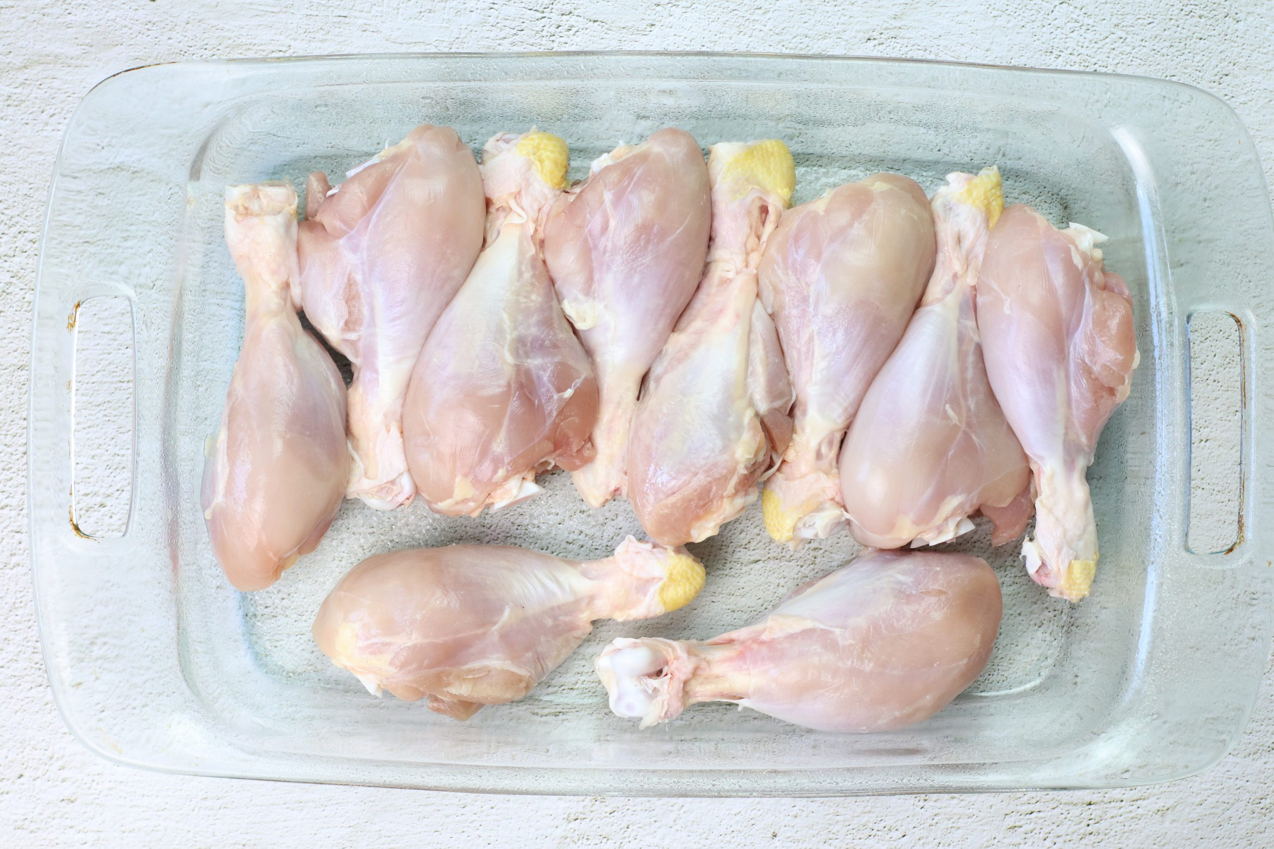 raw chicken in a baking dish