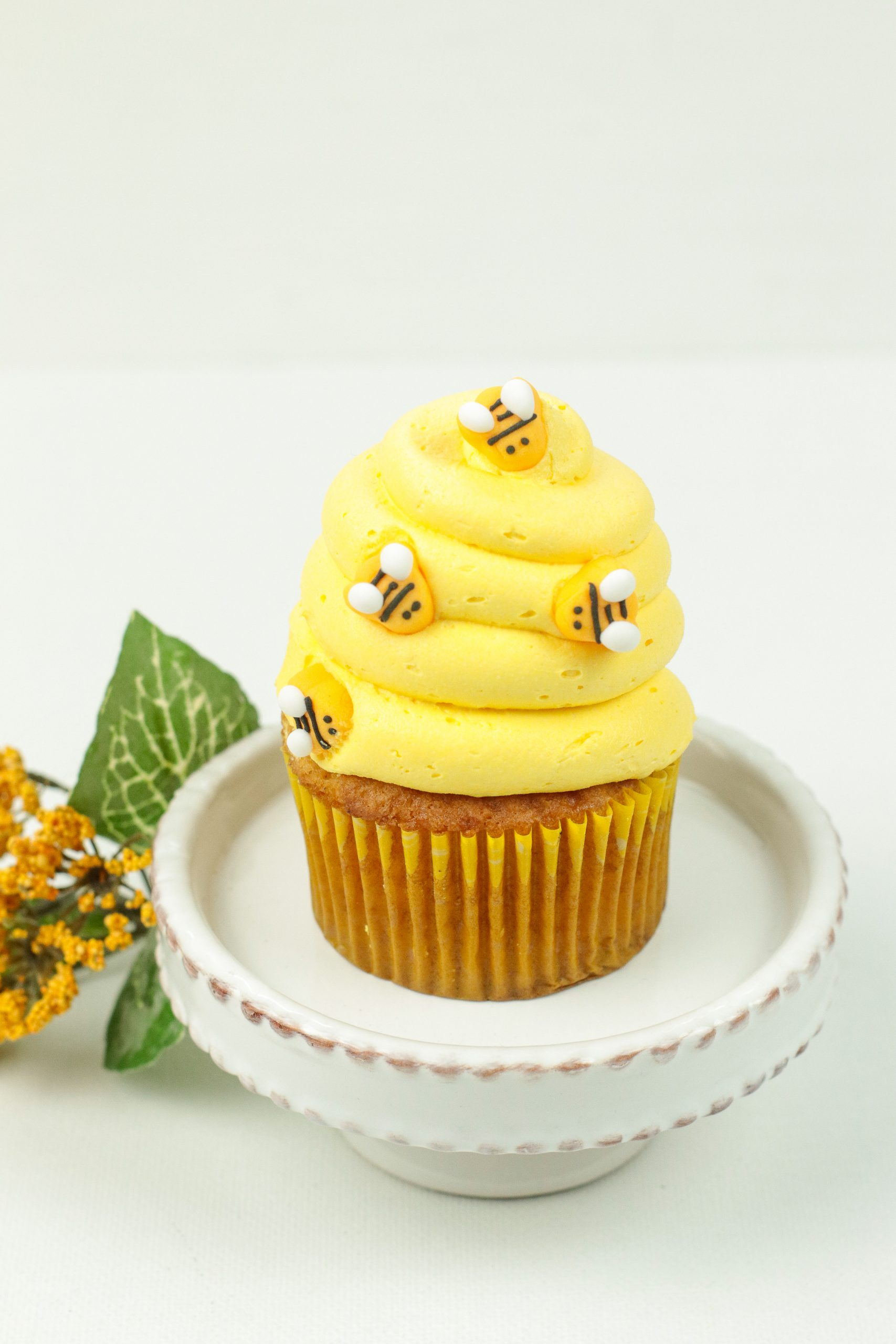 A close up of one of the Honey Cinnamon Bumblebee Cupcakes.