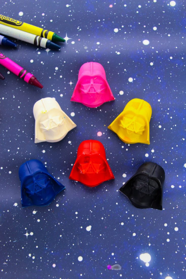 Multi-colored Darth Vader Crayons on a table