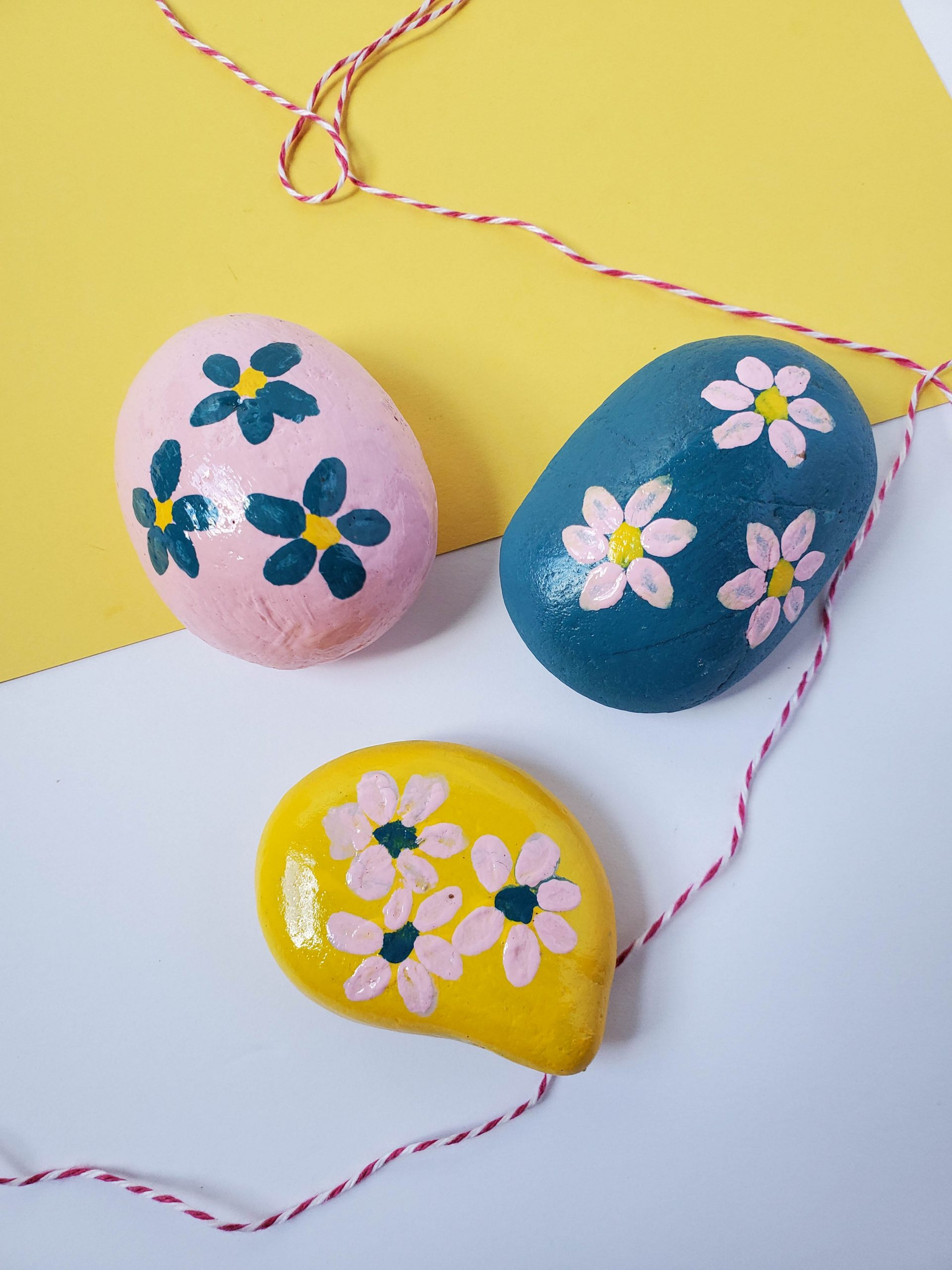 The painted rocks with a piece of striped string.
