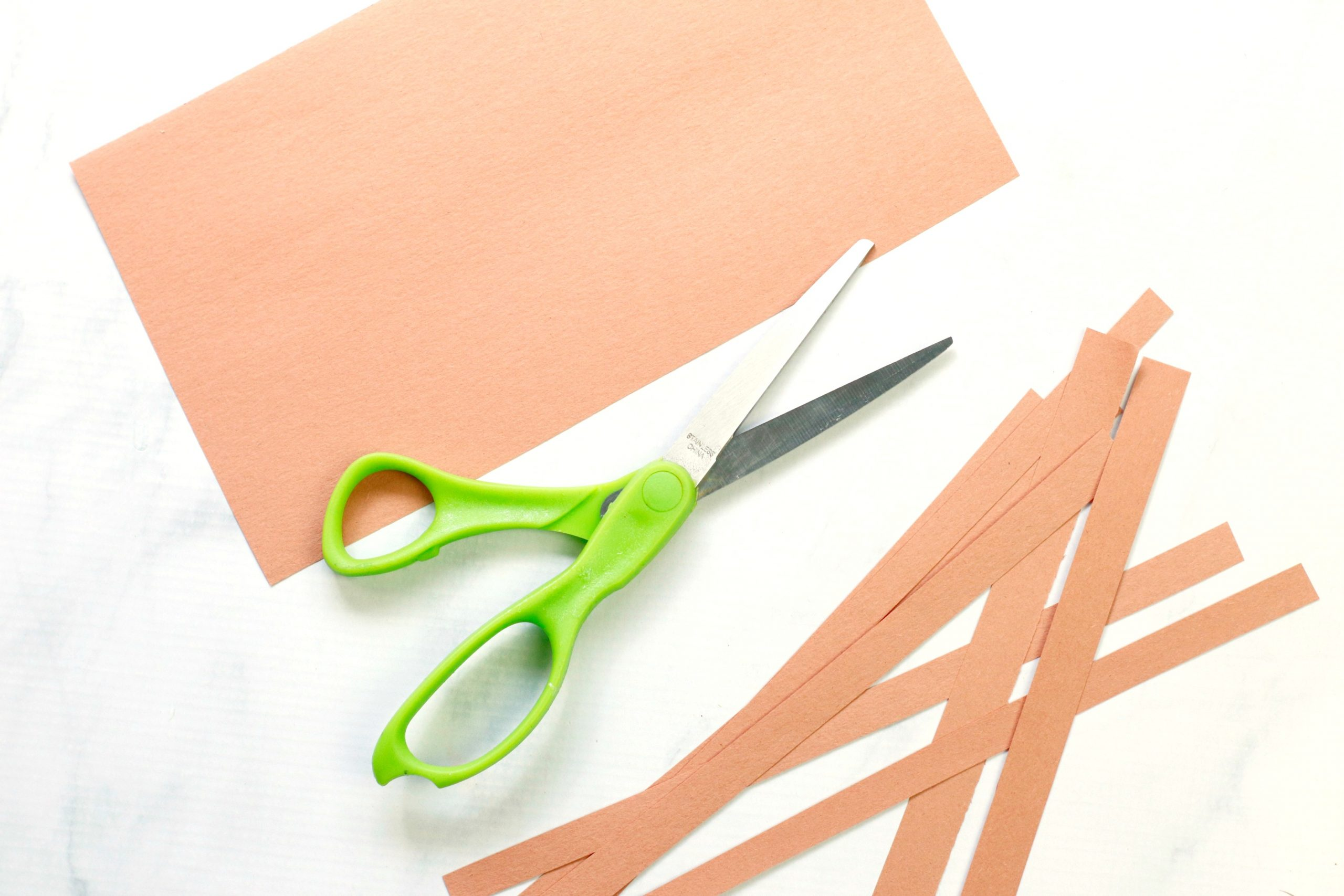 Cutting out strips of paper.
