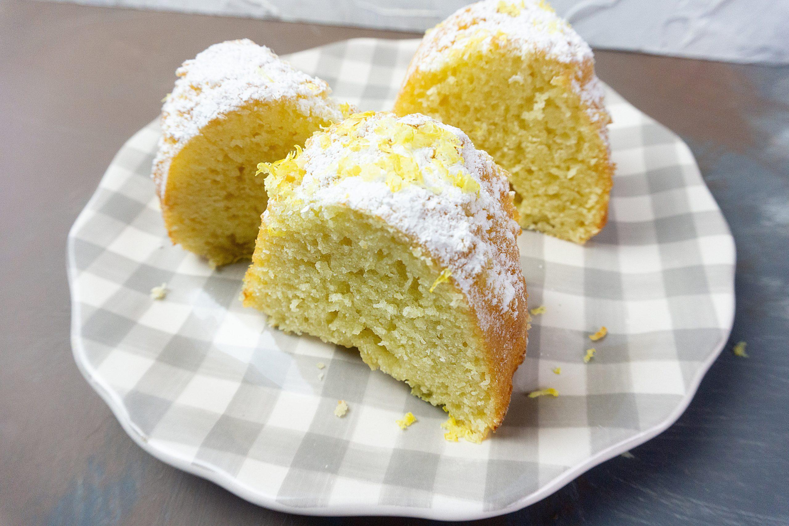 Meyer Lemon Bundt Cake on a grey and white checkered plate.