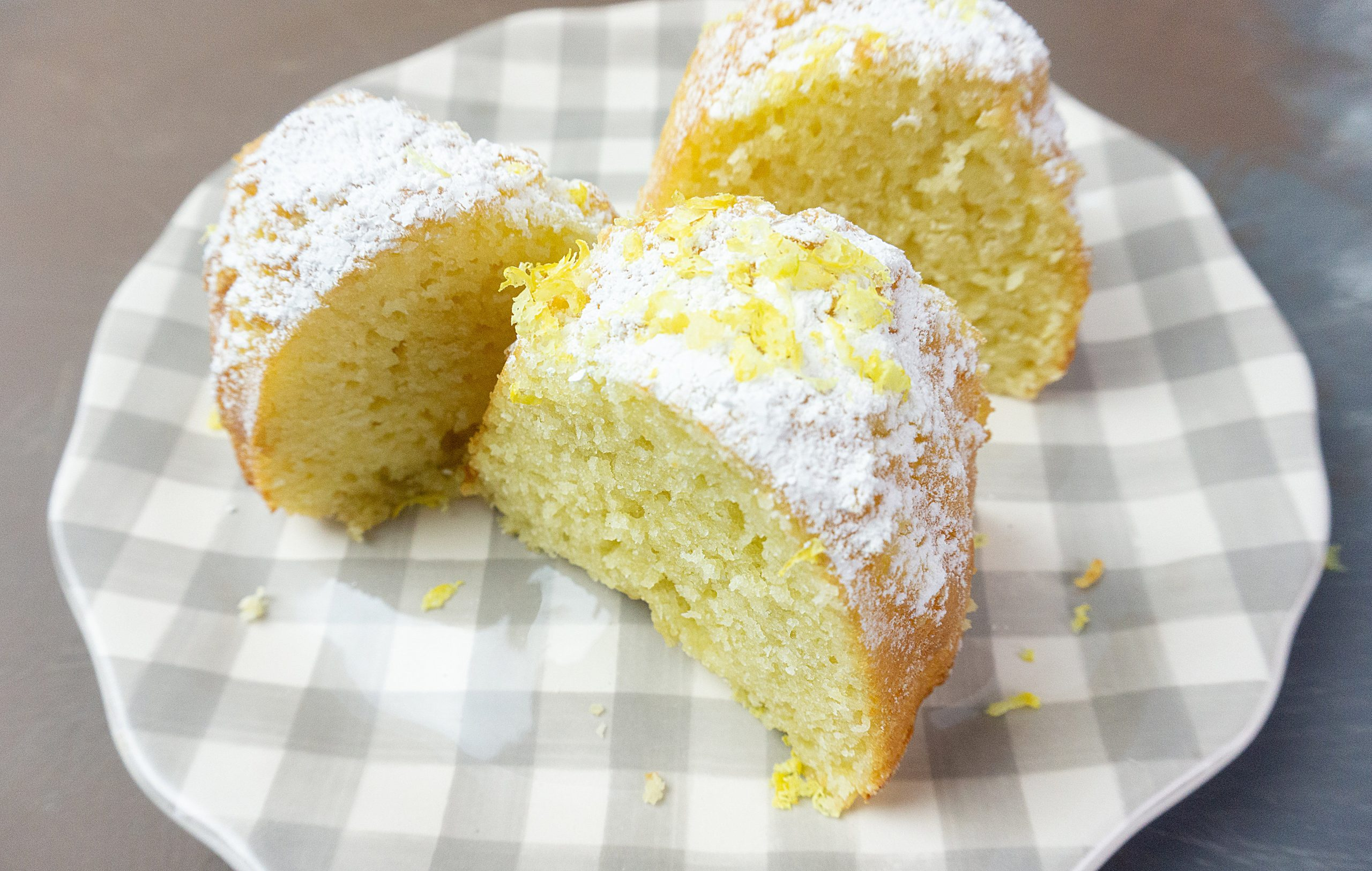 Meyer Lemon Bundt Cake topped with powdered sugar and lemon zest.