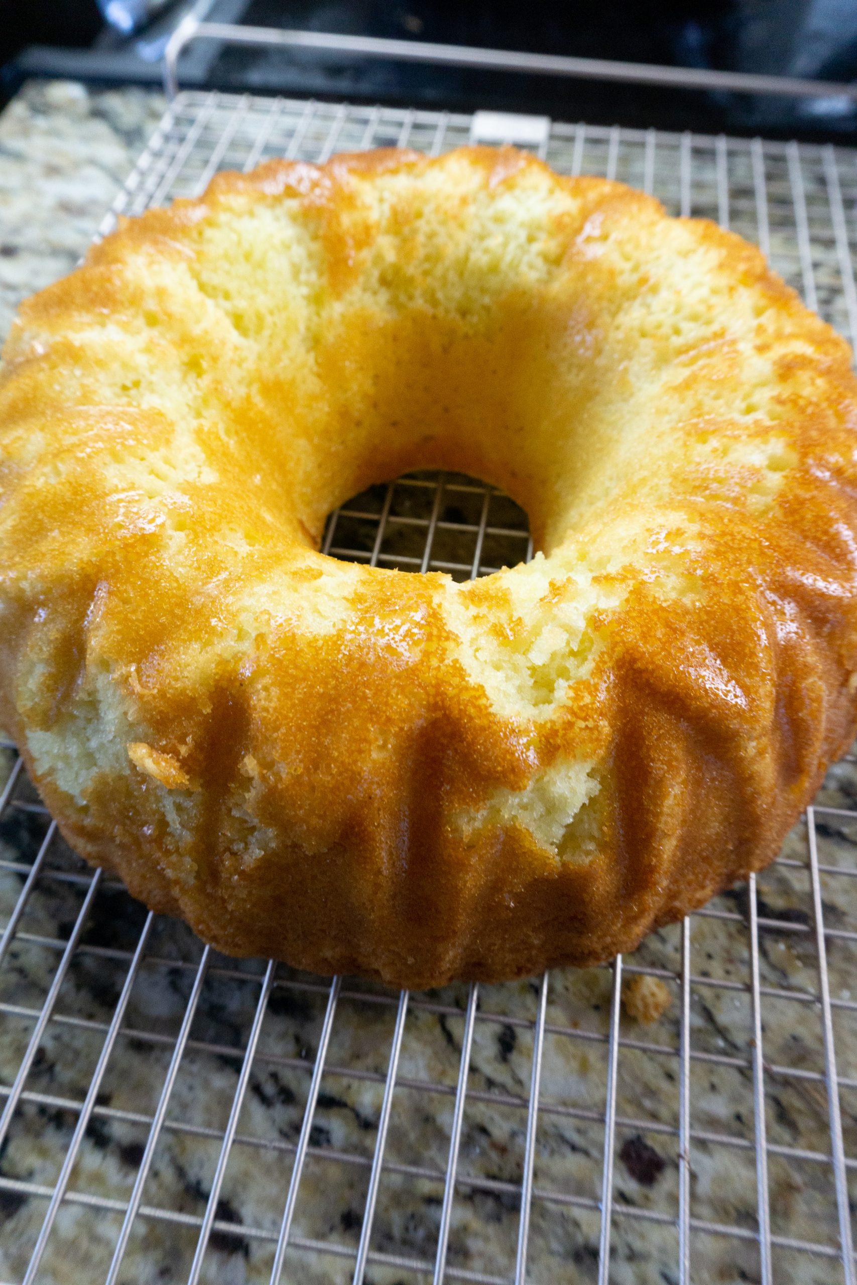 Meyer Lemon Bundt Cake on a wire rack cooling.