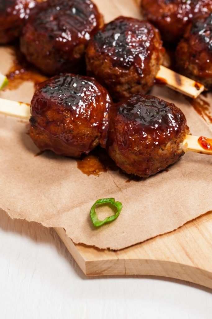 BBQ meatballs with a green onion