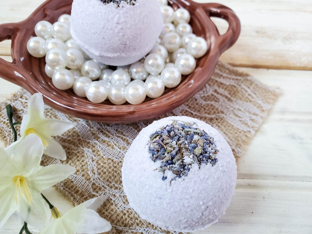 Lavender Eucalyptus Bath Bombs with flowers on the side.