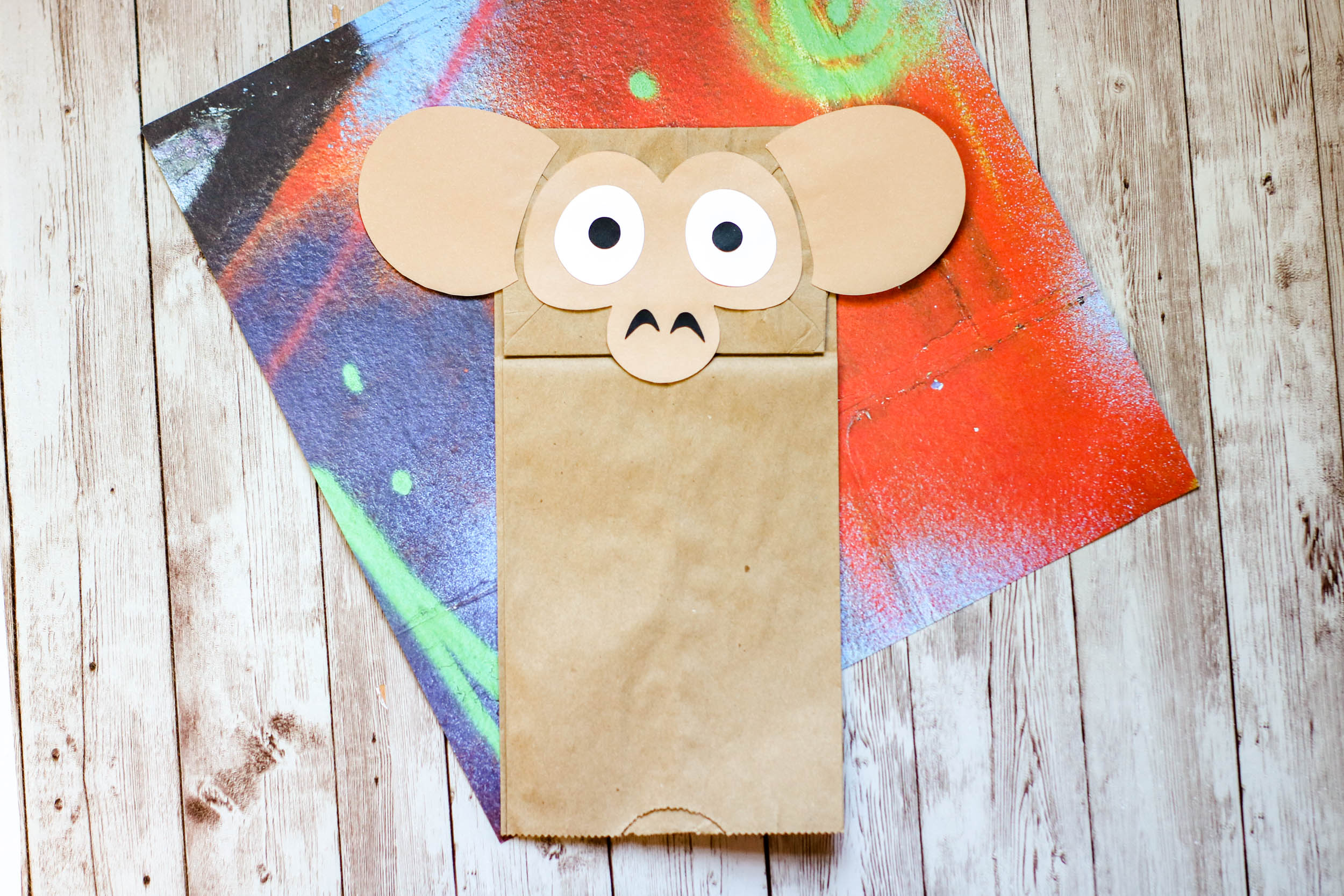 The brown paper bag monkey on a table.
