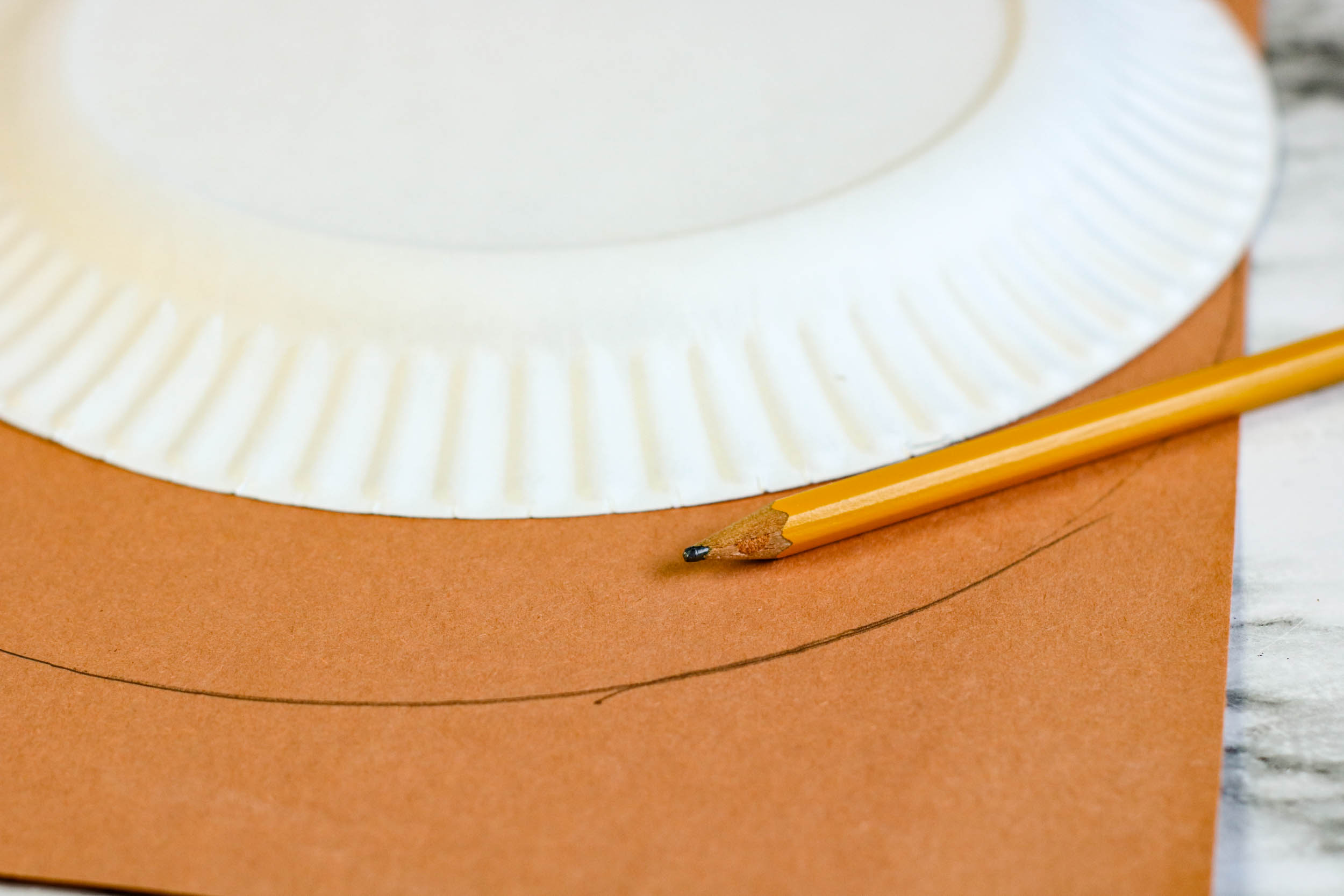 Tracing out the paper plate.