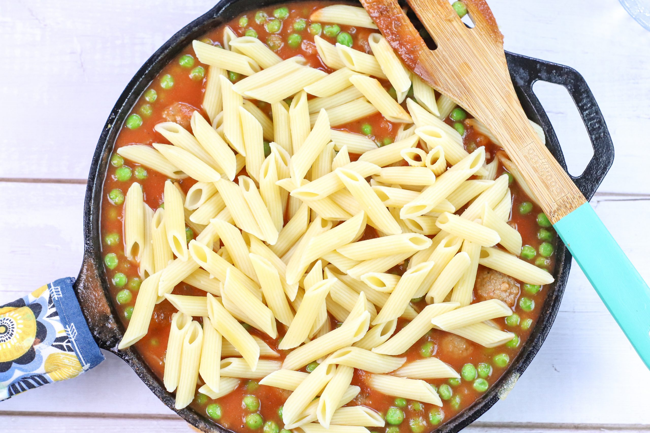 pasta in the skillet with other ingredients