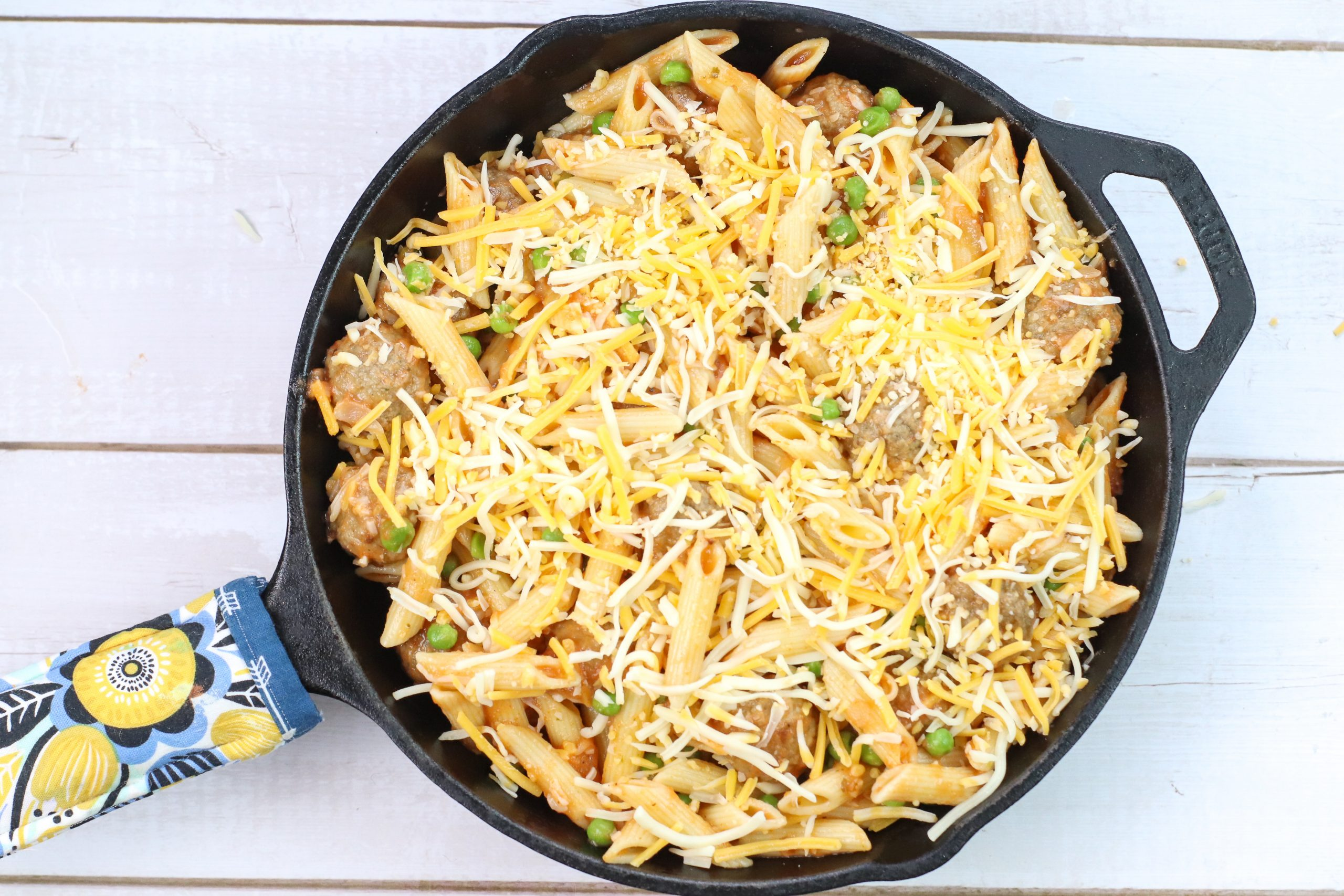 skillet meatball pasta topped with cheese