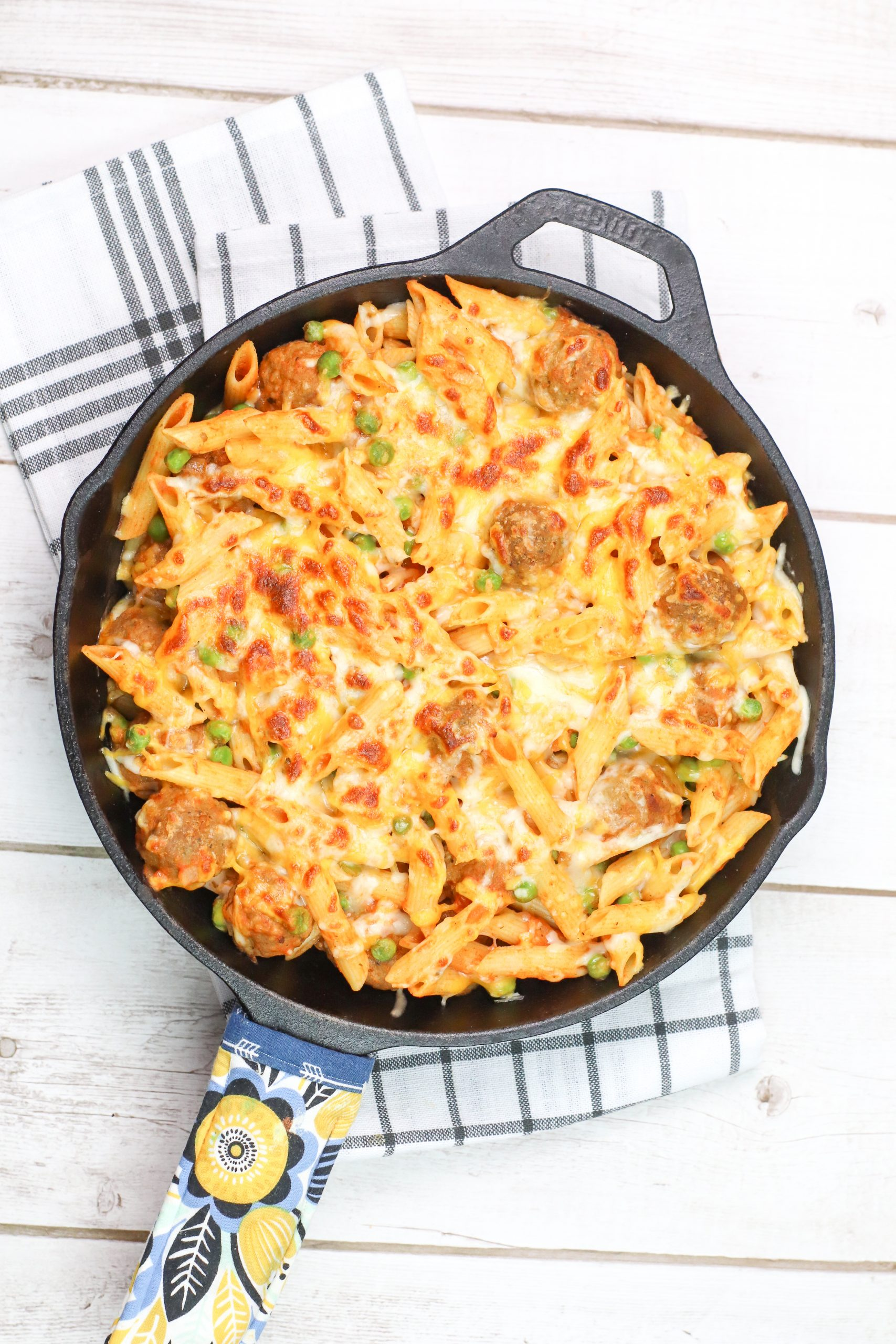 skillet with pasta and meatballs
