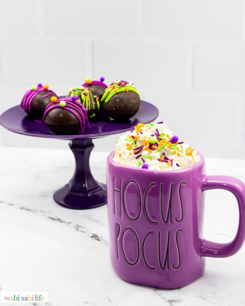 The mug of cocoa and the bombs on a table.