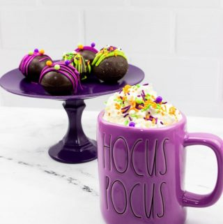 The cocoa bombs on a stand.