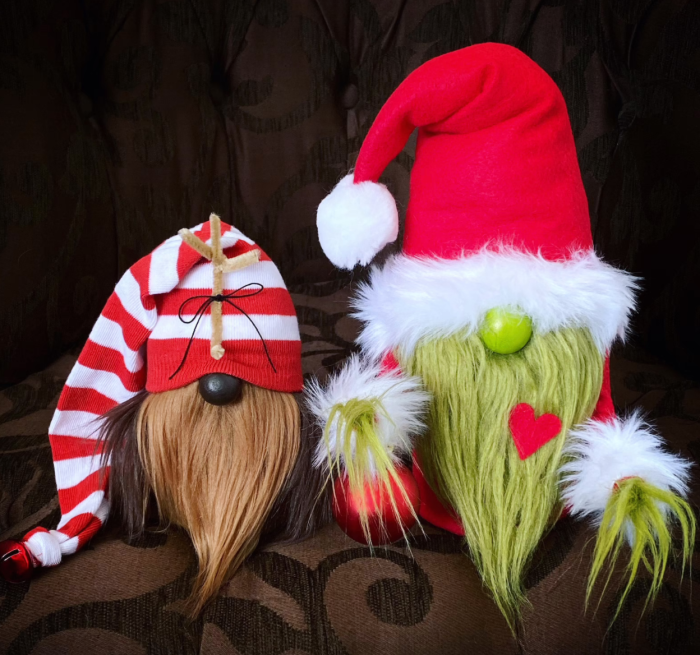 Grinch and Max gnome on a brown pillow.