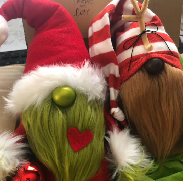 Grinch and Max gnomes wearing hats.